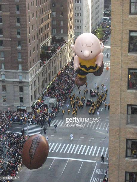 CONTENT] A balloon shaped like the cartoon character Charlie Brown chases another balloon shaped like an American football down New York City's Sixth...