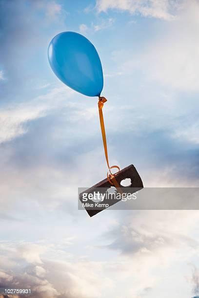 Balloon tied to a brick