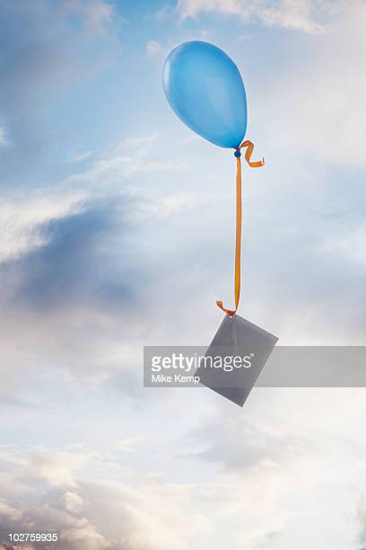 Balloon tied to an envelope