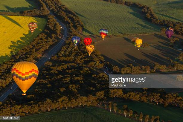 A balloon with spectators follows competitors during day 3 of the Australian National Ballooning Championships 2017 on September 6 2017 in Northam...