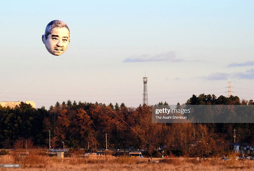 A balloon with the face of an 'ojisan' (middle-aged man) floats in the sky above the Kinugawa river on December 14, 2014 in Utsunomiya, Tochigi, Japan. It was actually a balloon bearing the 15-meter-by-7-meter face of an 'ojisan' (a middle-aged man), floated by the Utsunomiya Museum of Art to give residents an opportunity to appreciate art outside an exhibition room. The aim was to inspire residents to discover attractions in their community and communicate with each other. For the latest project, the artists selected the face of a man who they thought best represented the image of an ojisan out of the 218 facial images they collected in central Utsunomiya. The event will be held again at an elementary school in the city on December 20.