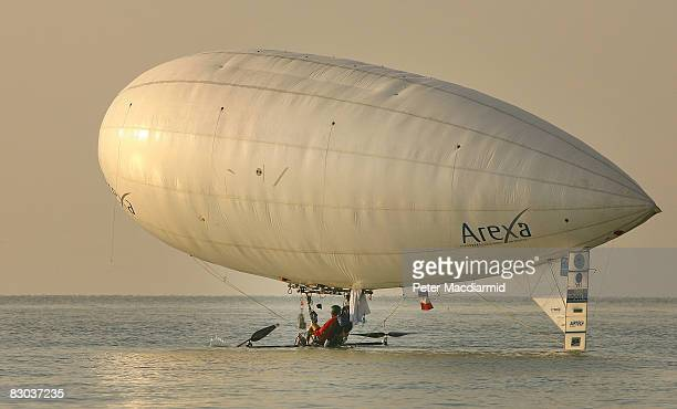 Balloonist Stephane Rousson accidentally dips his pedal powered airship in the sea on September 28 2008 off Hythe England Amateur pilot Rousson...