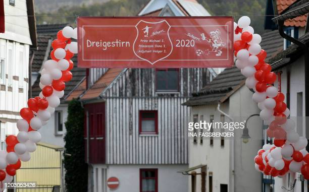 Balloons and a banner with the names of the local carnival triumvirate decorate a street for carnival in Volkmarsen near Kassel central Germany on...