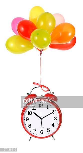 Ballons und Uhr