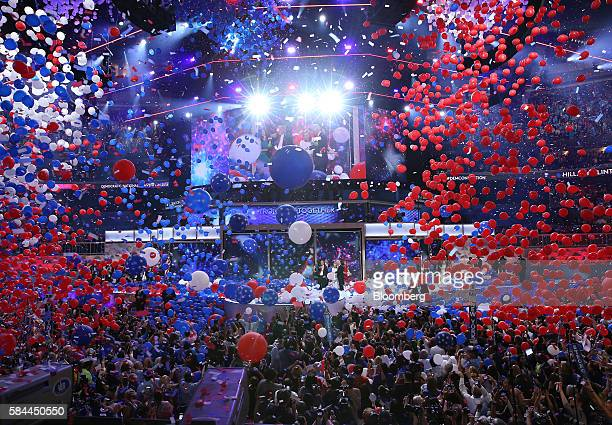 Balloons and confetti drop as Hillary Clinton, 2016 Democratic presidential nominee, stands on stage during the Democratic National Convention in...