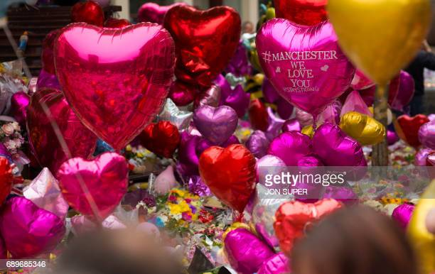 Balloons and floral tributes are pictured in St Ann's Square in Manchester northwest England on May 29 placed in tribute to the victims of the May 22...