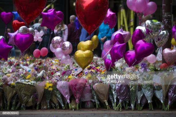Balloons and flowers are pictured before a vigil in St Ann's Square in Manchester north west England on May 29 placed in tribute to the victims of...