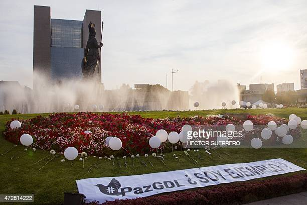 Balloons and flowers are placed on the ground at the Minerva font after a march for peace in Guadalajara in the Mexican state of Jalisco on May 9...