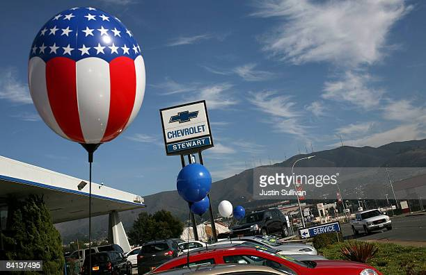 Balloons are attached to cars for sale at Stewart Chevrolet December 29 2008 in Colma California General Motors and Chrysler are scheduled to receive...