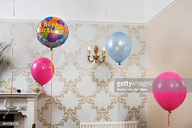 balloons are floating in room. - happy birthday vintage stockfoto's en -beelden