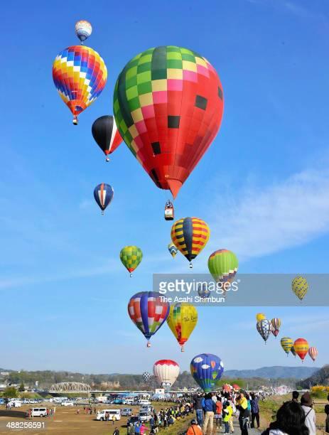 Balloons are flying during the Saku Balloon Festival at Chikuma River on May 3 2014 in Saku Nagano Japan