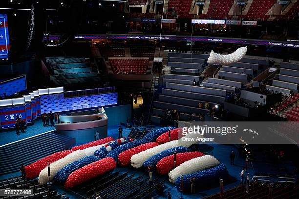 Balloons are hoisted to the rafters at the Wells Fargo Center July 22 2016 in Philadelphia Pennsylvania The Democratic National Convention will...