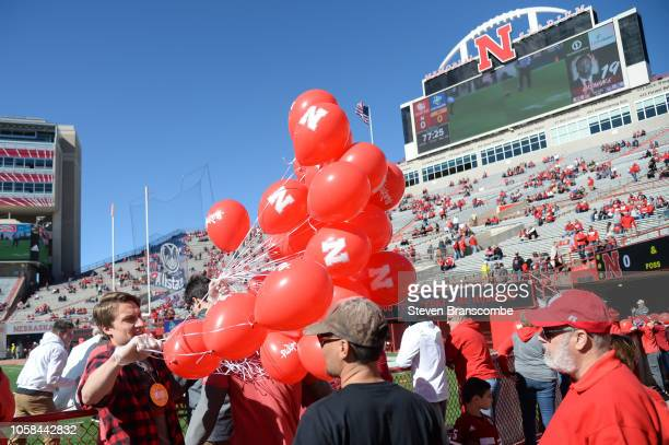 Balloons are passed out before the game between the Nebraska Cornhuskers and the Minnesota Golden Gophers at Memorial Stadium on October 20 2018 in...