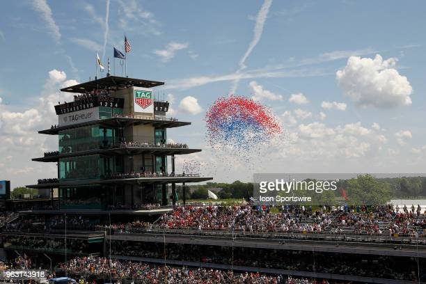Balloons are released behind the pagoda prior to the start of the Indianapolis 500 on May 27 at the Indianapolis Motor Speedway in Indianapolis...
