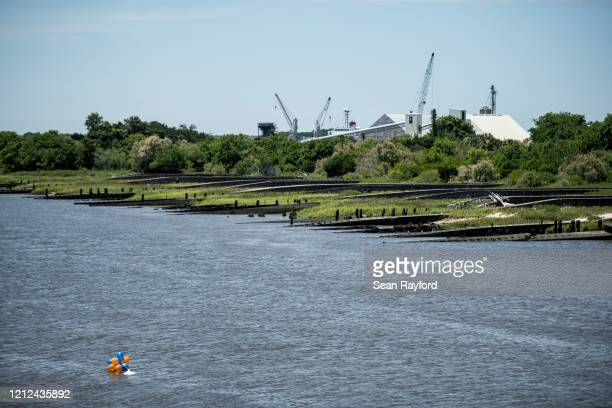 Balloons are released to honor the life of Ahmaud Arbery float in the East River on May 9, 2020 in Brunswick, Georgia. Arbery was shot and killed...