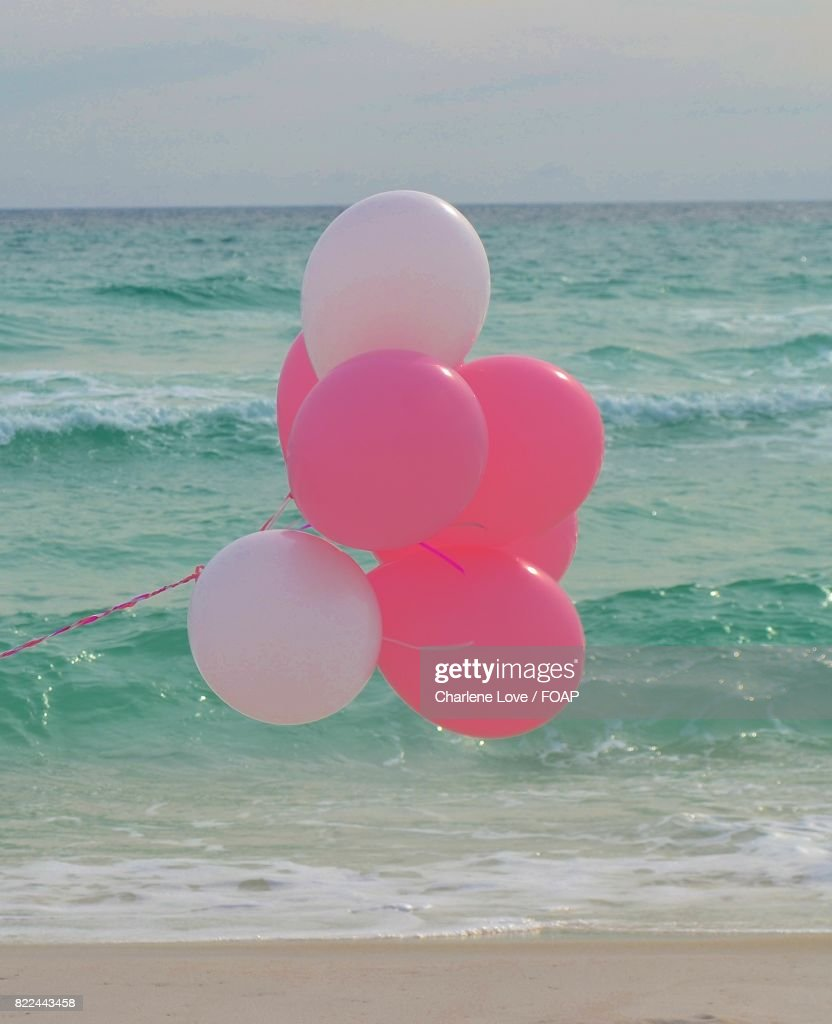 Balloons at the beach : Stock Photo