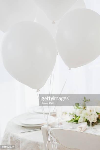 Balloons at wedding table setting, studio shot