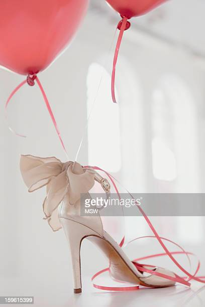 Balloons attached to high heel