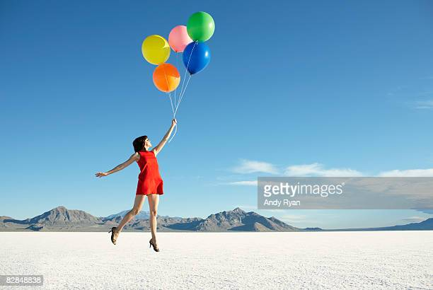 balloons carrying off young woman - 空中 ストックフォトと画像