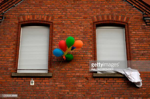 Balloons decorate a house for carnival in Volkmarsen near Kassel central Germany on February 25 2020 A car that rammed into a carnival procession in...