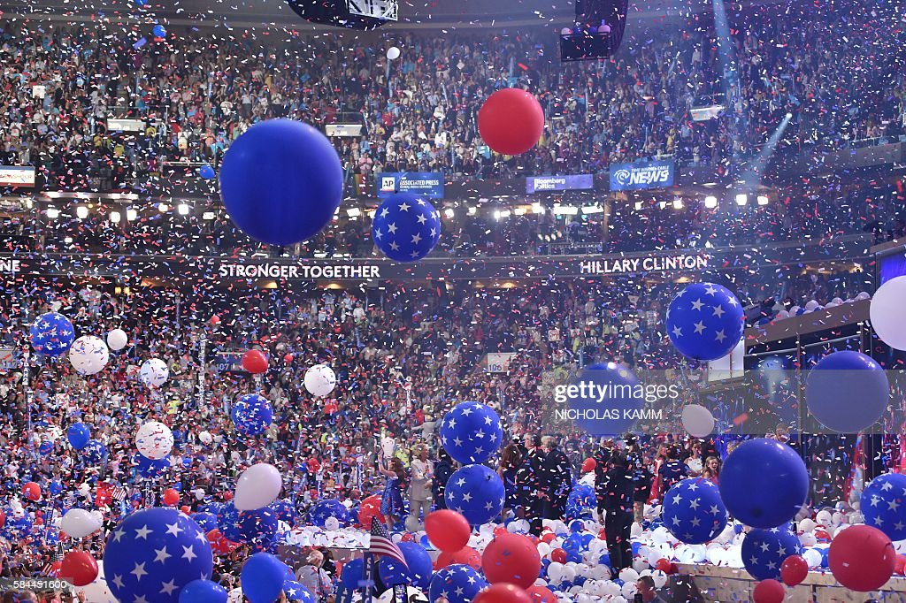 Balloons descend as Democratic presidential nominee Hillary Clinton celebrates on the fourth and final night of the Democratic National Convention at Wells Fargo Center on July 28, 2016 in Philadelphia, Pennsylvania. / AFP / Nicholas Kamm