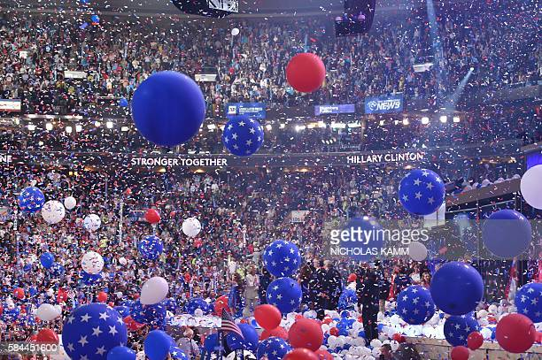 Balloons descend as Democratic presidential nominee Hillary Clinton celebrates on the fourth and final night of the Democratic National Convention at...