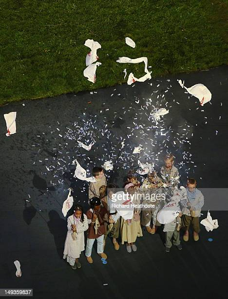 Balloons explode filled with confetti during the Opening Ceremony of the London 2012 Olympic Games at the Olympic Stadium on July 27 2012 in London...