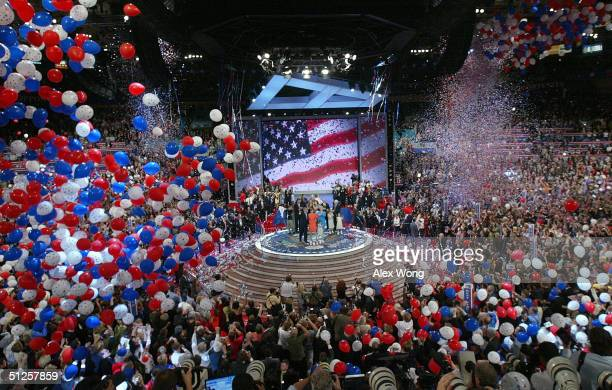 Balloons fall from the ceiling following U.S. President George W. Bush's speech accepting his party's nomination on the final night of the Republican...