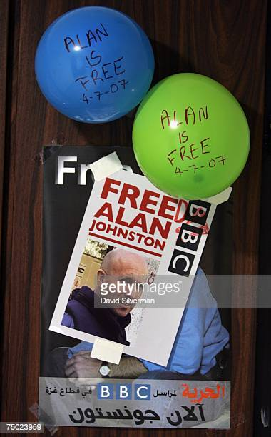 Balloons featuring the handwritten message Alan Is Free and a Free Alan campaign poster amended to Freed adorn the door of the BBC Middle East bureau...