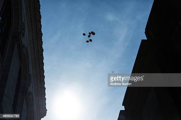 Balloons float above the finish line of the Boston Marathon on April 21 2014 in Boston Massachusetts Today marks the 118th Boston Marathon security...