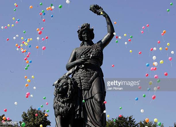 Balloons float by the Bavaria statue on September 25 2005 at the Oktoberfest in Munich Germany Bands from all the beer tents meet for the annual...