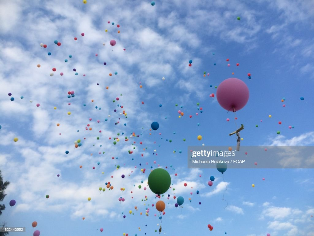 Balloons floating in air : Stock Photo