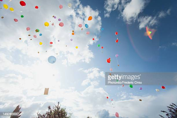 balloons floating toward sky - releasing stock photos and pictures