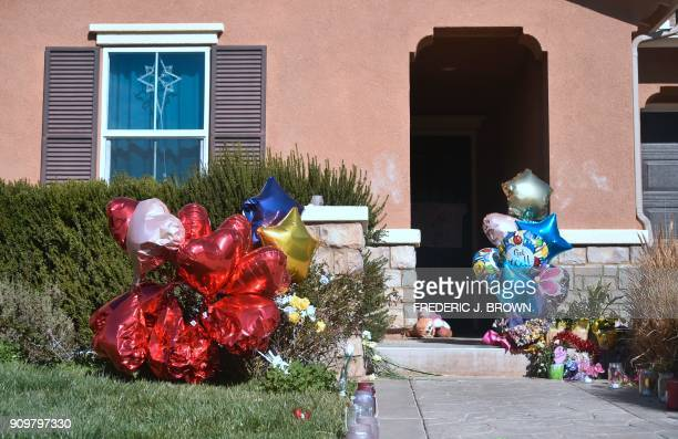 TOPSHOT Balloons flowers and other momentos are left in front of the Turpin family's home in Perris California on January 24 ahead of another court...