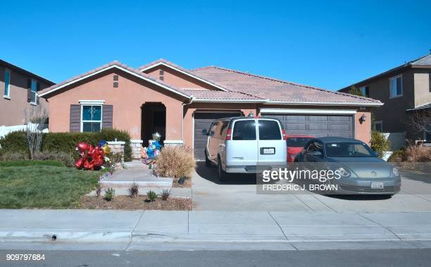 Balloons flowers and other momentos are seen in front of the Turpin family's home in Perris California on January 24 ahead of another court hearing...