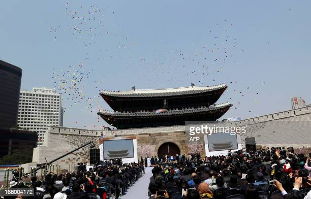 Balloons fly during the reopening ceremony of Namdaemun gate in Seoul on May 4 2013 South Korea on May 4 reopened its landmark Namdaemun gate to the...