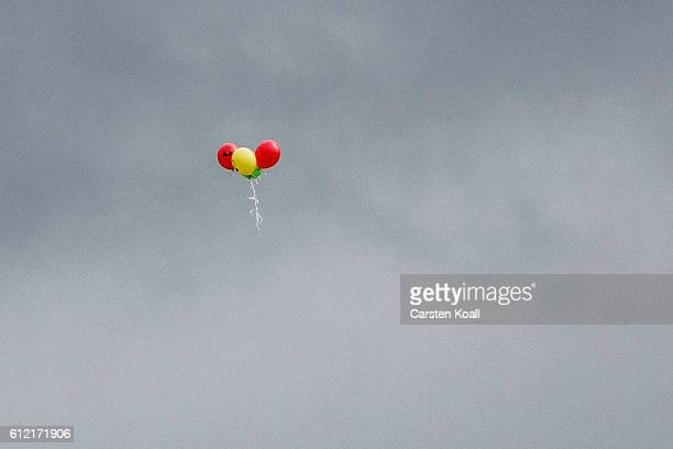 Balloons fly in the sky as people attend a ralley of right wing citizens movement 'Festung Europa' on German Unity Day on October 3 2016 in Dresden...