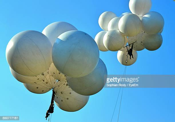 Balloons Flying Against Clear Sky