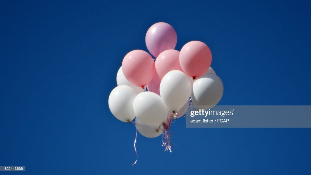 Balloons flying in clear sky : Stock Photo