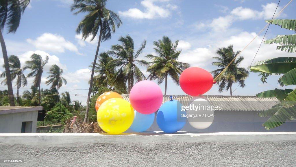 Balloons hanging on balcony : Stock Photo