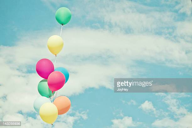 Balloons in against sky