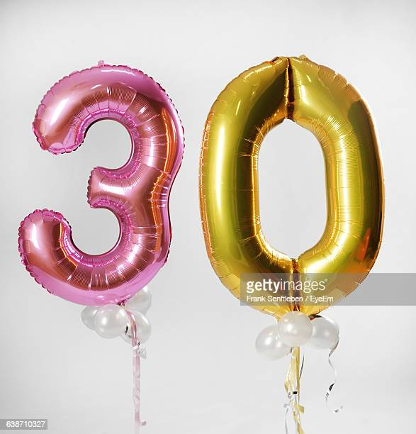 balloons in shape of numbers against white background - numbers stock photos and pictures