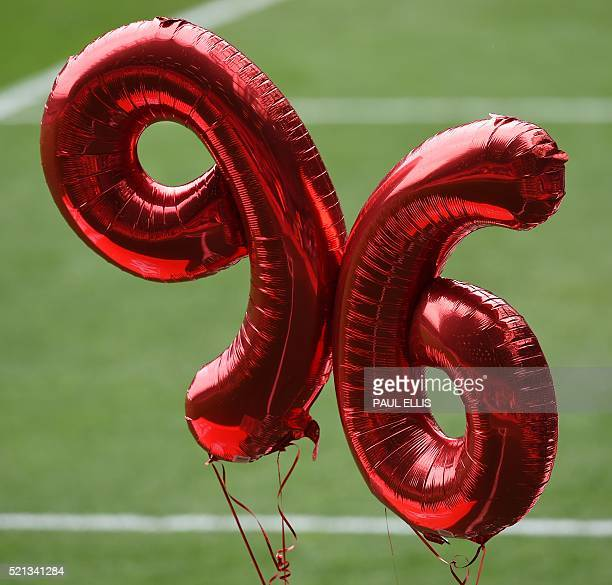 Balloons make the number '96' during a memorial service at Anfield in Liverpool north west England on April 15 on the 27th anniversary of the...