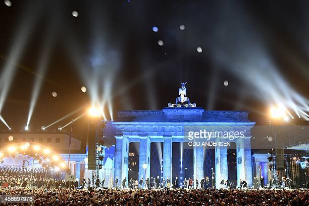 Balloons of the light installation Lichtgrenze sail into the night from the former route of the Berlin Wall during a Street Party organized by German...