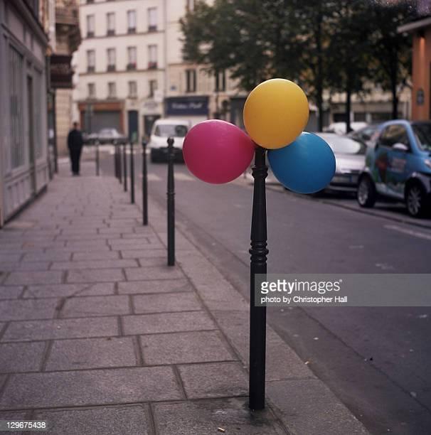 Balloons on street pole
