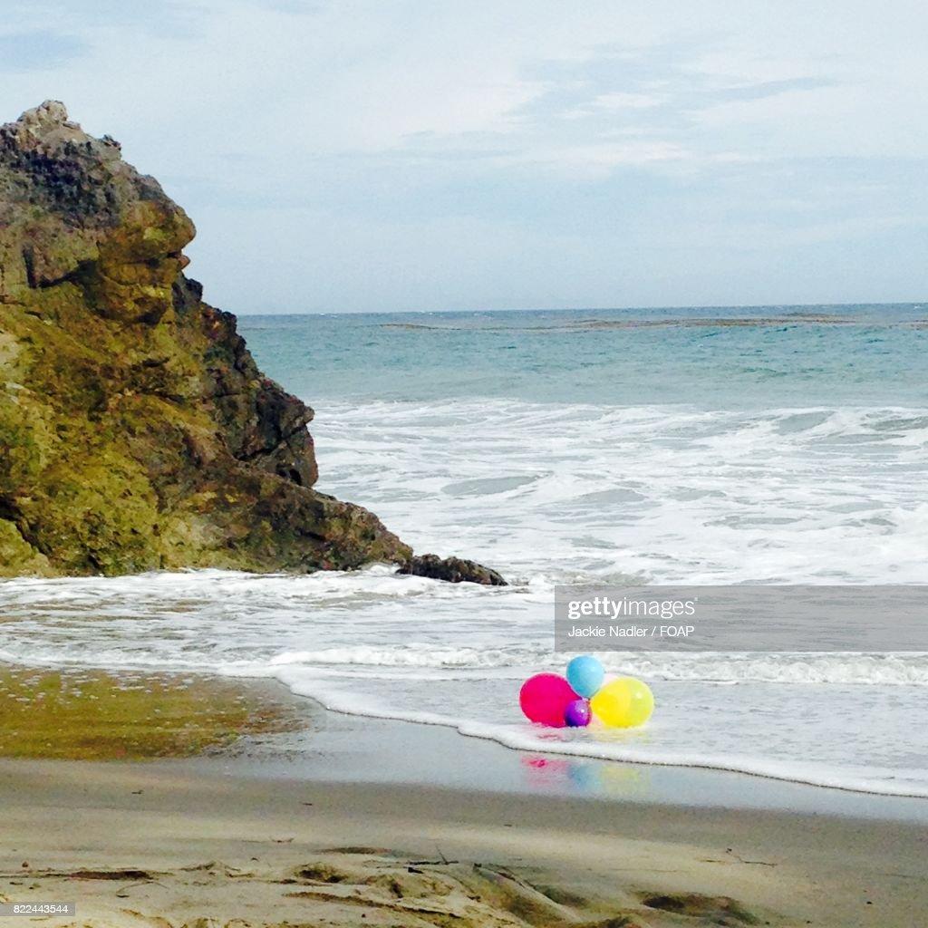 Balloons on the beach : Stock Photo