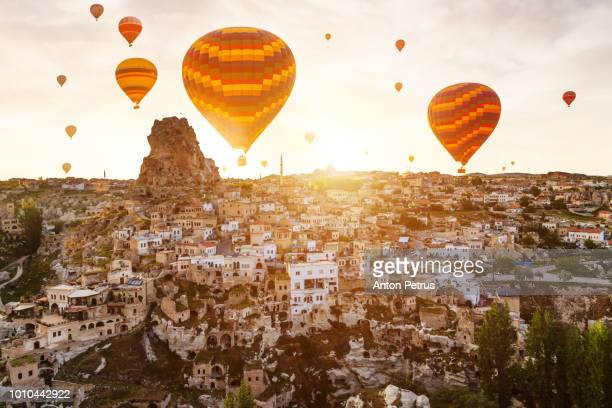 Balloons over the ancient city of Ortahisar, Cappadocia, Turkey
