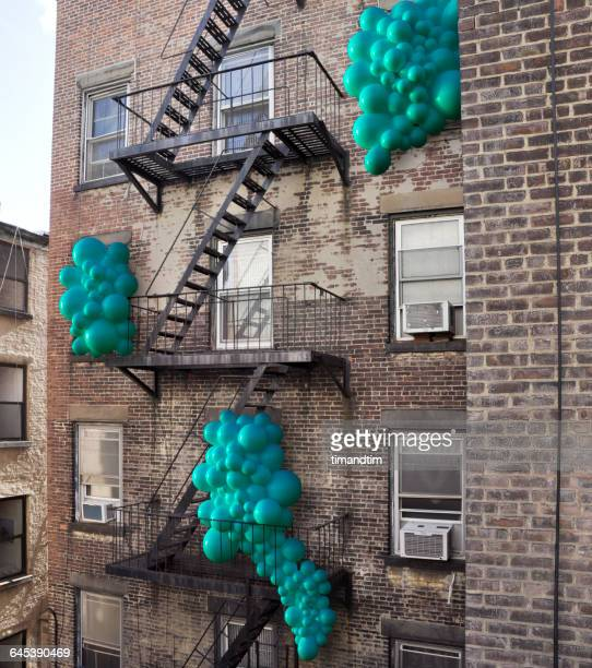 Balloons popping out through windows