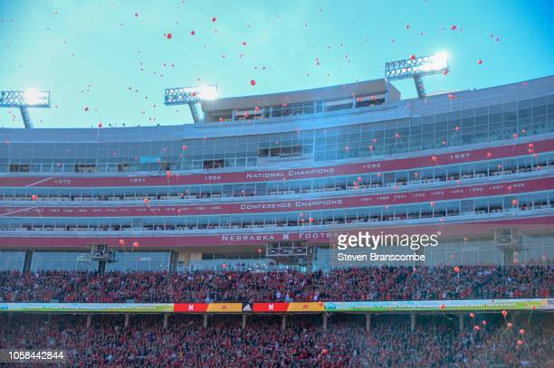 Balloons released after the first score in the game between the Nebraska Cornhuskers and the Minnesota Golden Gophers at Memorial Stadium on October...