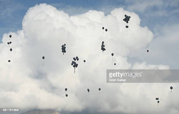 Balloons released by family members of Germanwings flight 4U9525 crash victims rise into the sky following a memorial ceremony for the last victims...
